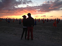 A couple of lovers in front of a sunset on  «les planches»